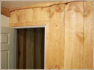Custom Cut Paneling And Live Edge Crown Molding For A Vintage Look